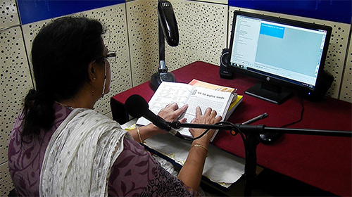 Photo of lady recording a book